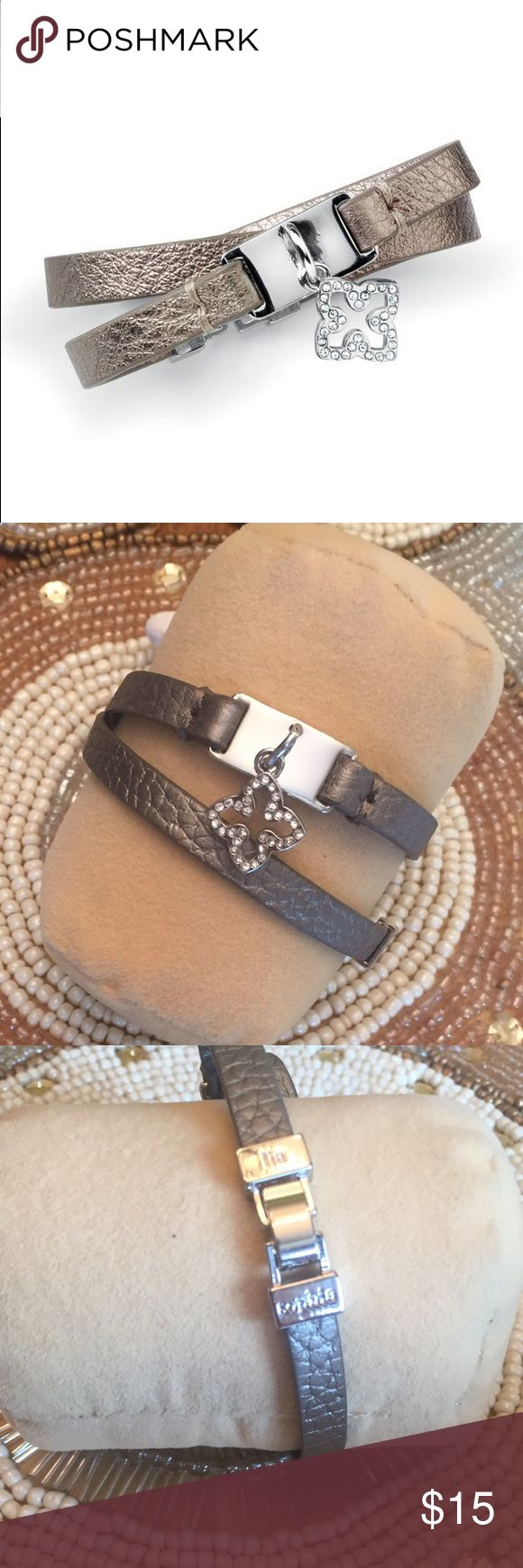 "Lia Sophia RETIRED Lattice Wrap Bracelet  Metallic taupe leather double wrap bracelet with a dangling, crystal-covered clover charm. Bracelet is 7"" with fold-over clasp. Both clasp and charm are in polished silver. EUC with little to no signs of wear. Lia Sophia Jewelry Bracelets"
