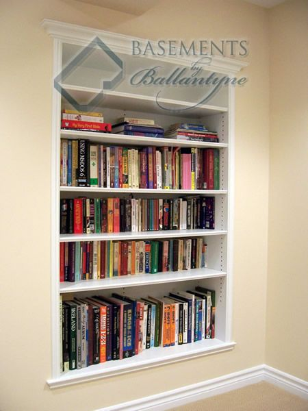 recessed bookshelves in between the wall studs, talk about space saving!! Put in hallway for cookbook storage