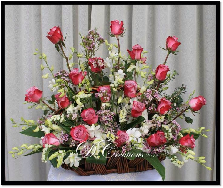 Lovely maroon/pink roses with pink Australian wax flowers and white orchids