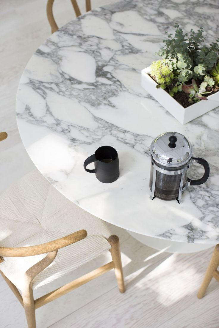 Kitchen island marble top round marble top dining tables french marble - The Stunning White Wishbone Chairs Oak Limewashed Floors Paired With A Dramatic White Marble Table Top Give Coastal Styling A Luxury Take