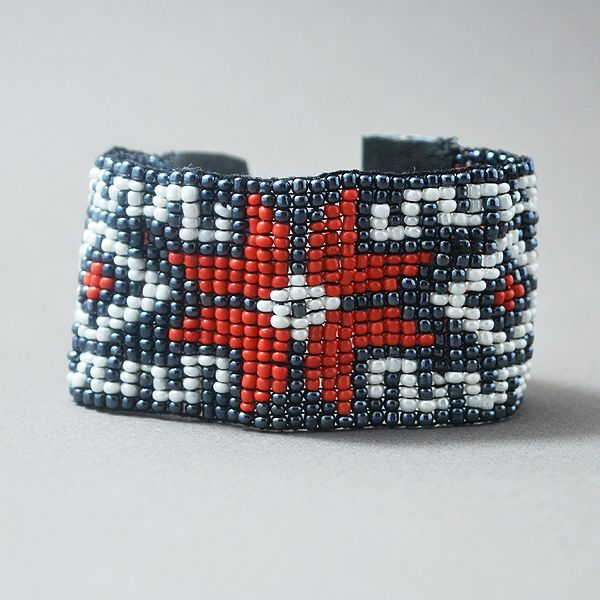 A carefully hand woven beaded bracelet, made of high quality beads. The bracelet is adjustable and the colors used are: White, metallic black & red. The bracelet's dimensions are: 1,57 inches (4 cm) in width (19 lines) and 6.3 inches (16 cm) in length. Since there is a huge variety of colors. I can create the perfect bracelet for you with no extra cost. Please contact me for any questions or clarifications.
