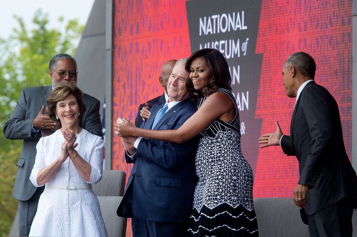 "Sept. 24, 2016 ""The First Lady hugs former President George W. Bush as she and President Obama take the stage during the opening ceremony of the Smithsonian National Museum of African American History and Culture in Washington, D.C."" (Official White House Photo by Chuck Kennedy)"