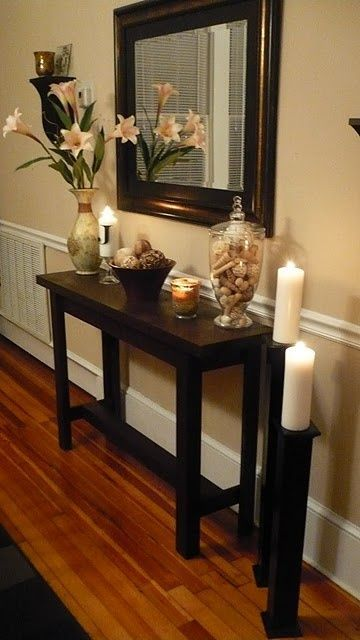 Entry table/hallway idea!! Love  console table, big mirror, floor candlestick, wood floor. Nice.