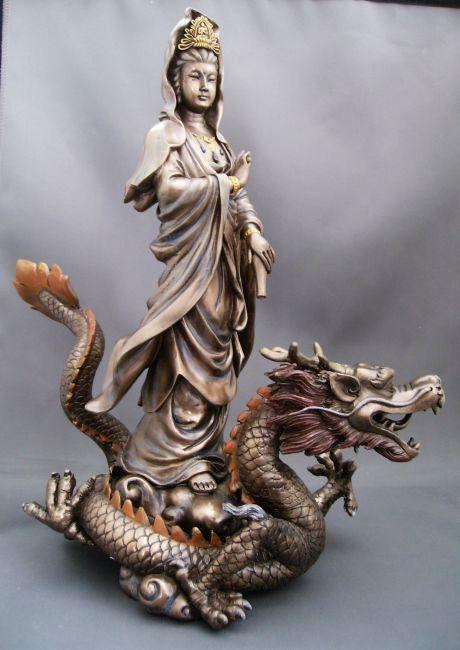 kwan yin on dragon statue