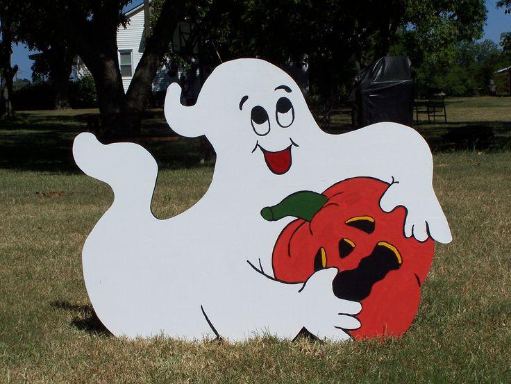 Laying Playful Ghost and his stolen pumpkin Halloween Yard Art Decoration. https://www.facebook.com/holidayyarddecorations