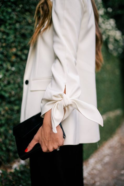 White blazer with statement bows on sleeves by Julia Hengel (Gal Meets Glam blog).