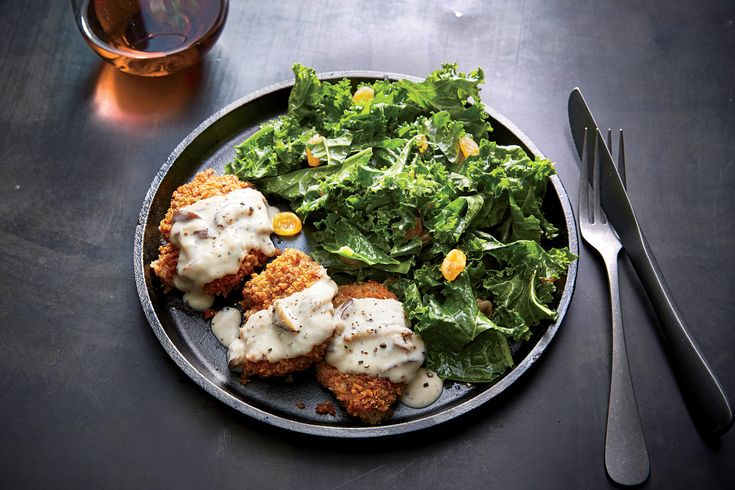 "Pork Milanese with Kale Salad | Milanese is Italian for ""breaded and sautéed until golden,"" an easy (and fast) way to dress up sliced pork tenderloin. Top the pork with a creamy mushroom sauce and serve with a simple kale salad for a complete meal. Golden raisins have a way of elevating everything they touch; try stirring into rice pilaf or sprinkling over roasted broccoli or Brussels sprouts. Remember to look for unseasoned pork tenderloin without brine (the label should have about 200mg or"