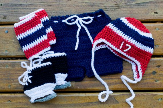 Hockey baby hockey outfit. Grandmabilt 6 piece outfit is hand crocheted for your little hockey star. USA or Canadien red, white and blue. The boys hat, pants socks and skates are made of a very soft bright acrylic yarn, suitable for infants. The set will fit most babies ages 0-3 mos and will stretch as baby grows! Please refer to the size chart below. Available in any team colour combination. I will presume you are ordering navy/red/white unless otherwise stated. The knit baby hocke...