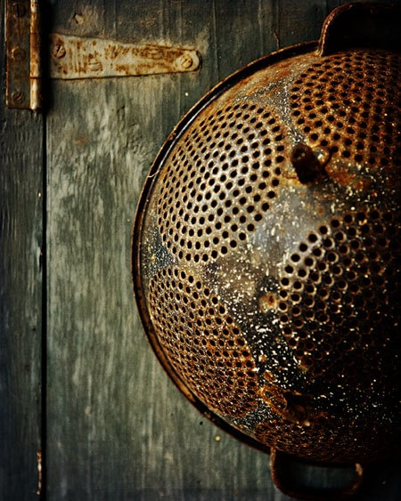old strainer...Reminds me of the little place we stayed at in France.The owners had used one as a wall light.Looked great.