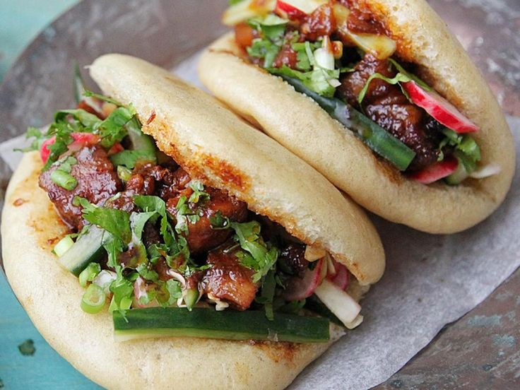 Taiwan – Gua Bao (pork buns) This gua bao recipe from Nisha Thomas offers useful tips on making these classic Taiwanese street food snacks. Packed with braised pork belly and garnished with tangy pickled vegetables, these buns are great for a party or get-together.