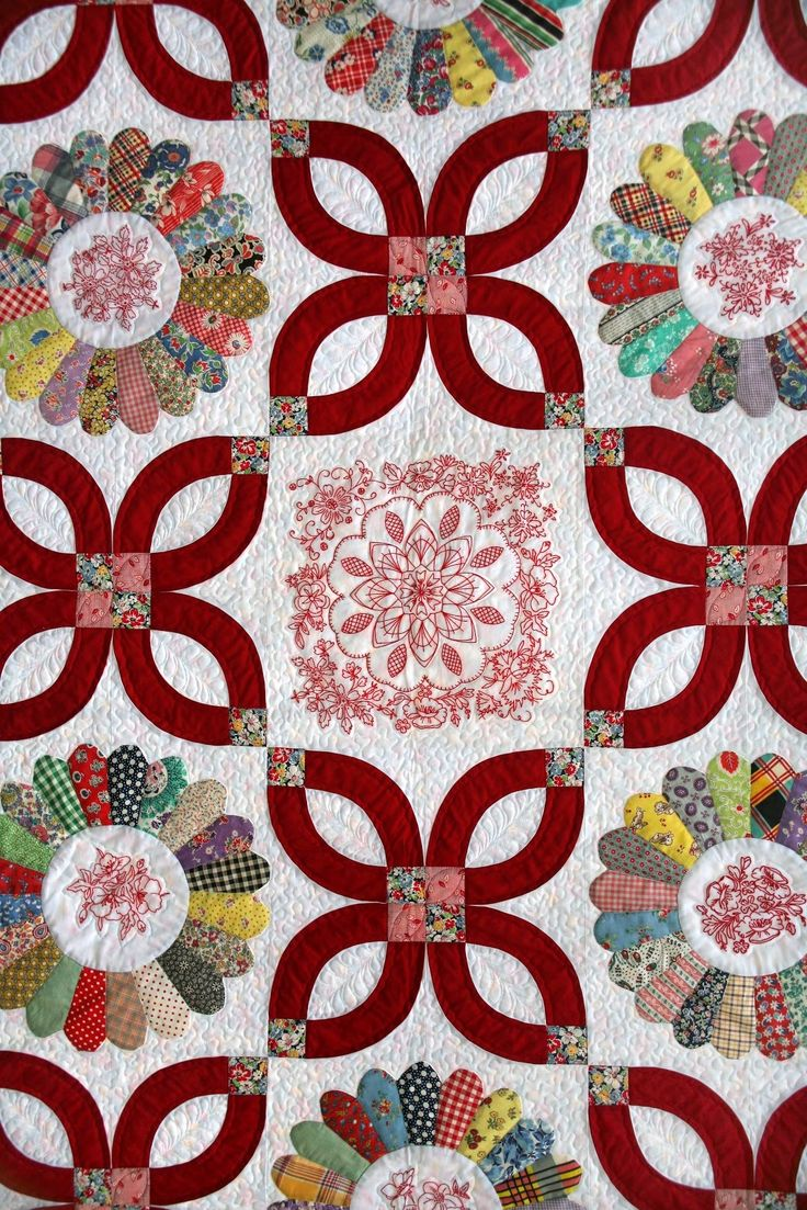 "close up, ""Dresden Delight"", 2013 raffle quilt at Westside Quilters Guild (Oregon). Vintage hand pieced Dresden plate blocks with redwork; wedding ring arcs shaped as flowers. Design by Jean Gordon."