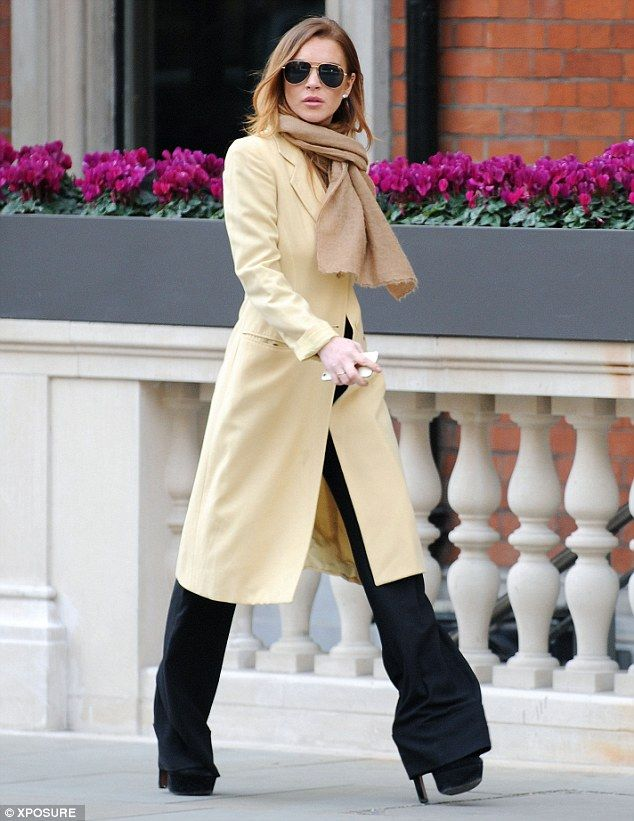 Walk this way: Lindsay Lohan opted for a pair of towering heels for a stroll in London on Thursday