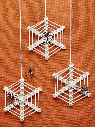 Oh, what a web we weave when making these for Halloween! Paint three craft sticks silver and let them dry. Glue them together at the center, forming an asterisk shape. Tie one end of a length of yarn (we used about 2 yards for one web) to the center of the sticks. Wrap it around the other spokes, then move outward, wrapping the sticks as shown. Tie off the yarn and add a plastic spider.