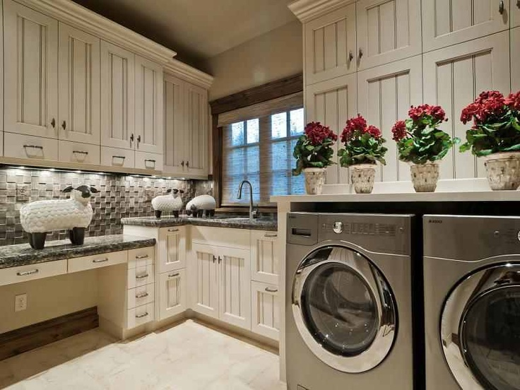The Washer & Dryer With Storage Above , Plenty Of Folding Space & Cabinets To Store Folded Laundry With A Sink
