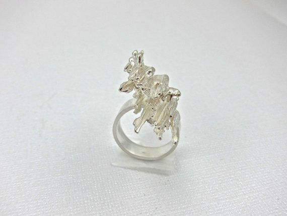 This bold sterling silver cocktail ring was made with a technique called broom casting. Molten silver is poured into a wet straw broom. It is a process where you will get a different result each time you do it which makes every piece unique. The sculpture that resulted this time