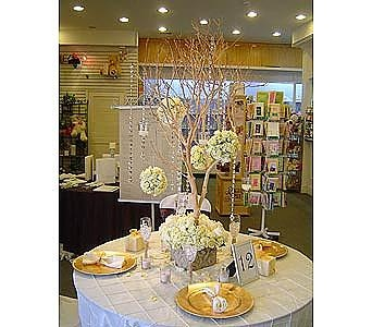 white manzanita branches with flower ball bouquets