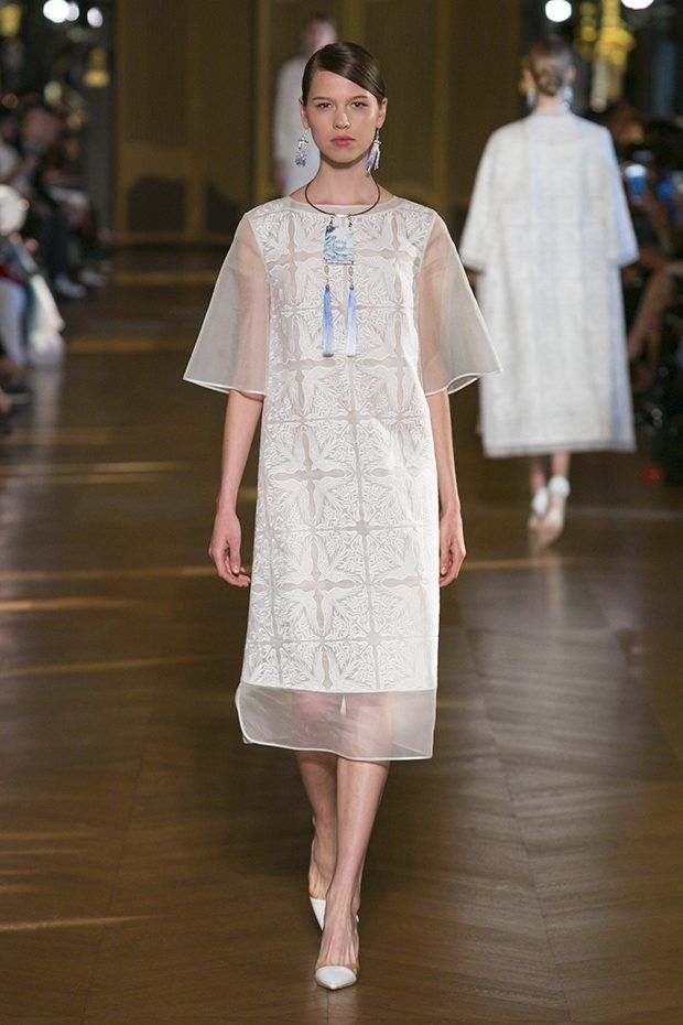 Chinese designer Xiong Ying presented her Spring Summer 2017 collection for Heaven Gaia during the recently wrapped up Paris Fashion Week. Inspired by Beijing's Old Summer Palace, the collection features dip-dyed silk, traditional Suzhou embroideries, silk tapestry and hand-painted motifs, as well as Mandarin collars and covered button fastenings.