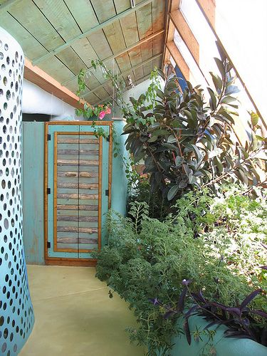 Refreshing colour scheme, glass bottle wall, indoor botanical cell, solarium windows. #earthship
