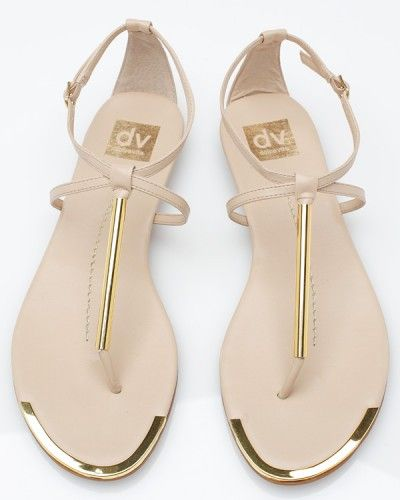 Archer In Nude    Dolce Vita    A fancier version of the thong sandal from Dolce Vita, featuring buckle ankle strap, criss-cross detail, and front gold accents.    Color    Size    $69.00