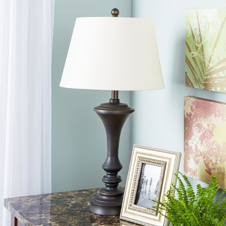 "29"" - $79 each - Brimming with classic style, this lovely luminary showcases a brushed copper finish and is topped with a cream-toned empire shade. The base design also features a turned base with elegant curves for an added touch of stately style."