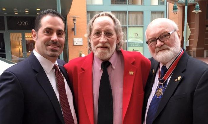 Ralph Morales, left, and Michael Reagan, right, with John Nunn, a Navy Corpsman who tried to save Vincent Santaniello's life in 1968 (Courtesy of Michael Reagan)
