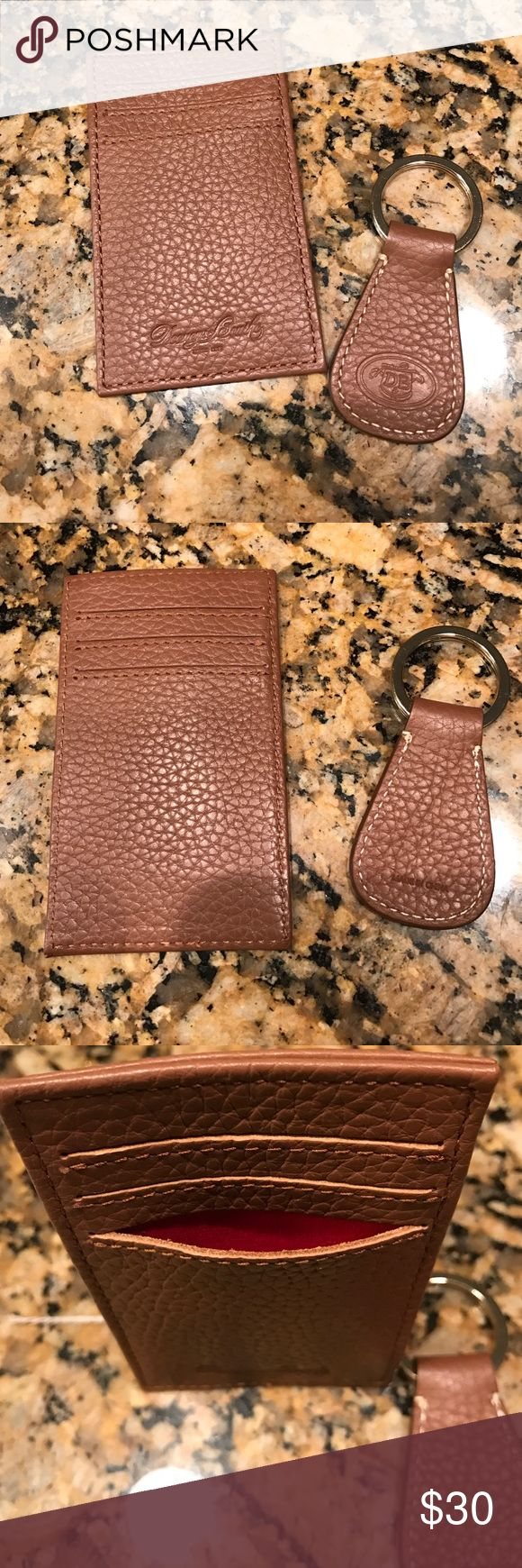 Dooney & Bourke key chain and card holder Brown never used D & B keychain and card holder. 3 slots on each side of mini wallet with red interior. LOWEST Dooney & Bourke Accessories Key & Card Holders