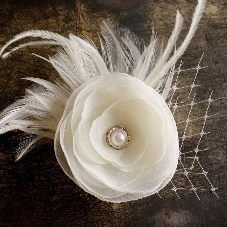 @Jenny O'Connor Hair Clip Wedding Flower Feather Ivory White Pearl. $38.00, via Etsy.