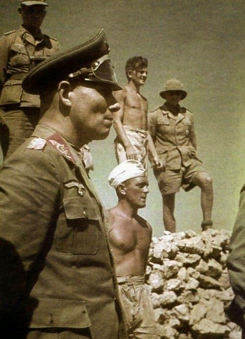 THE DESERT FOX  Field Marshal Erwin Rommel standing beside members of his Afrika Korps, N. Africa. Date taken: 1942.