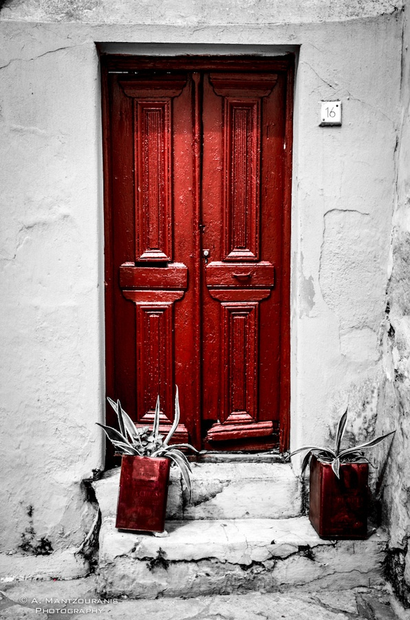 Random Street, Random Door. I wanted to give the feeling of a memory. Retained the strongest color as it could be kept in somebody's mind.