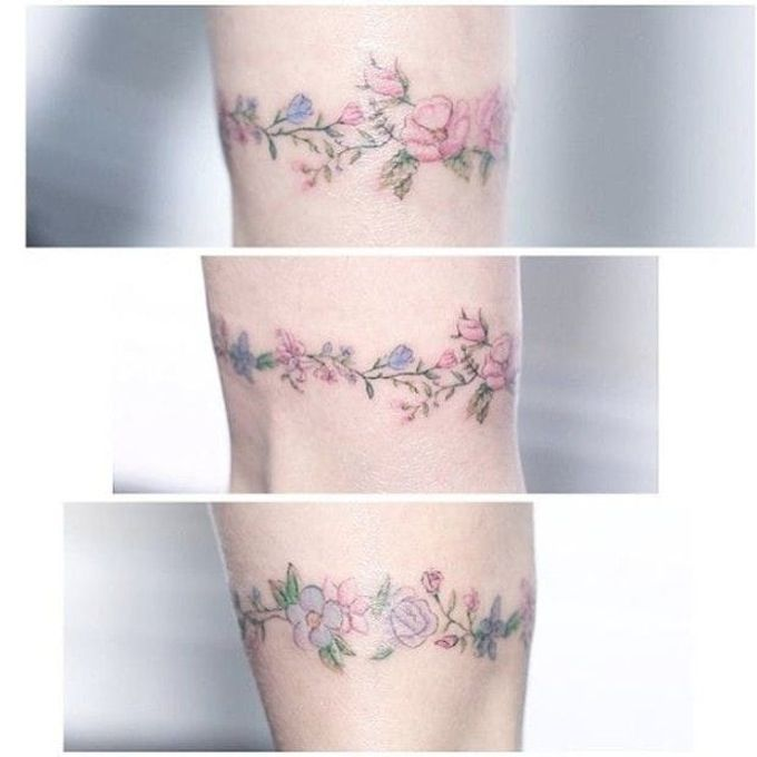 Floral bracelet tattoo by Mini Lau. #MiniLau #lavender #flower #floral #bracelet #band #lovely #subtle #fineline
