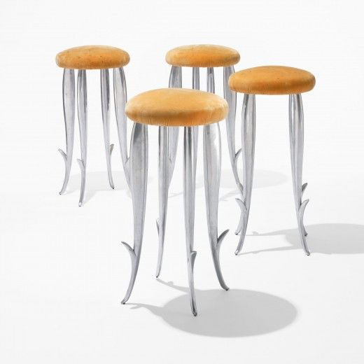 PHILIPPE STARCK    Royalton barstools, set of four    France, 1988  cast aluminum, upholstery  14 dia x 29 h inches  These stools were originally designed for the Royalton Hotel and were later put into production and manufactured by XO.