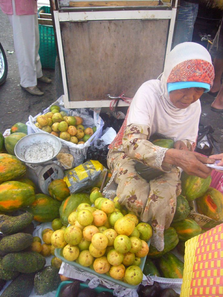 An old lady selling fruits at Kolombo Traditional Market, Jogjakarta