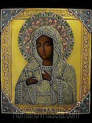 A Very Fine and Rare antique Russian icon of the Kaluga Mother of God with gilded silver, cloisonne enamel and filigree oklad (riza), made in Moscow between 1899 and 1908 by prominent silversmith Semyon Galkin who specialized in enameled icons. 10 1/2 x 12 in. (26,4 x 31 cm).
