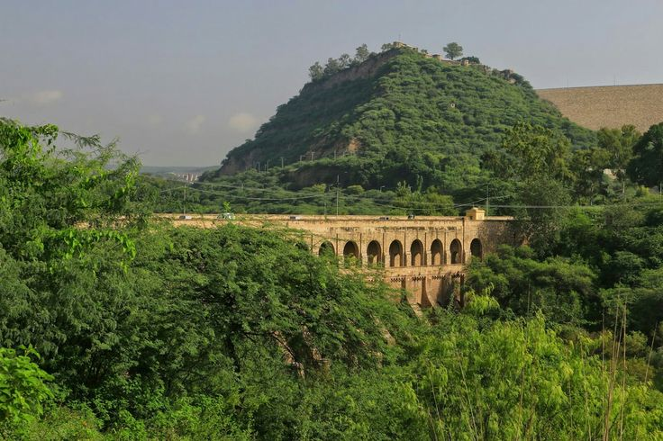 The old abandoned headworks of the Upper Jhelum Canal sits right below Mangla Fort seen on the skyline. Tumbling down the mountains of Kashmir, Jhelum River washed the hill of the fort before turning sharply to the right, forcing its flow in the direction of the headworks. This was the first major canal that drew off without a barrage or weir spanning the river.