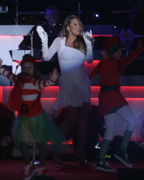 Mariah Carey Photos - Mariah Carey performs during the National Christmas Tree lighting ceremony at the Ellipse December 6, 2013 in Washington, DC. U.S. President Barack Obama and his family were joined by entertainers at the annual event to celebrate the holiday season. - First Family Attend National Christmas Tree Lighting