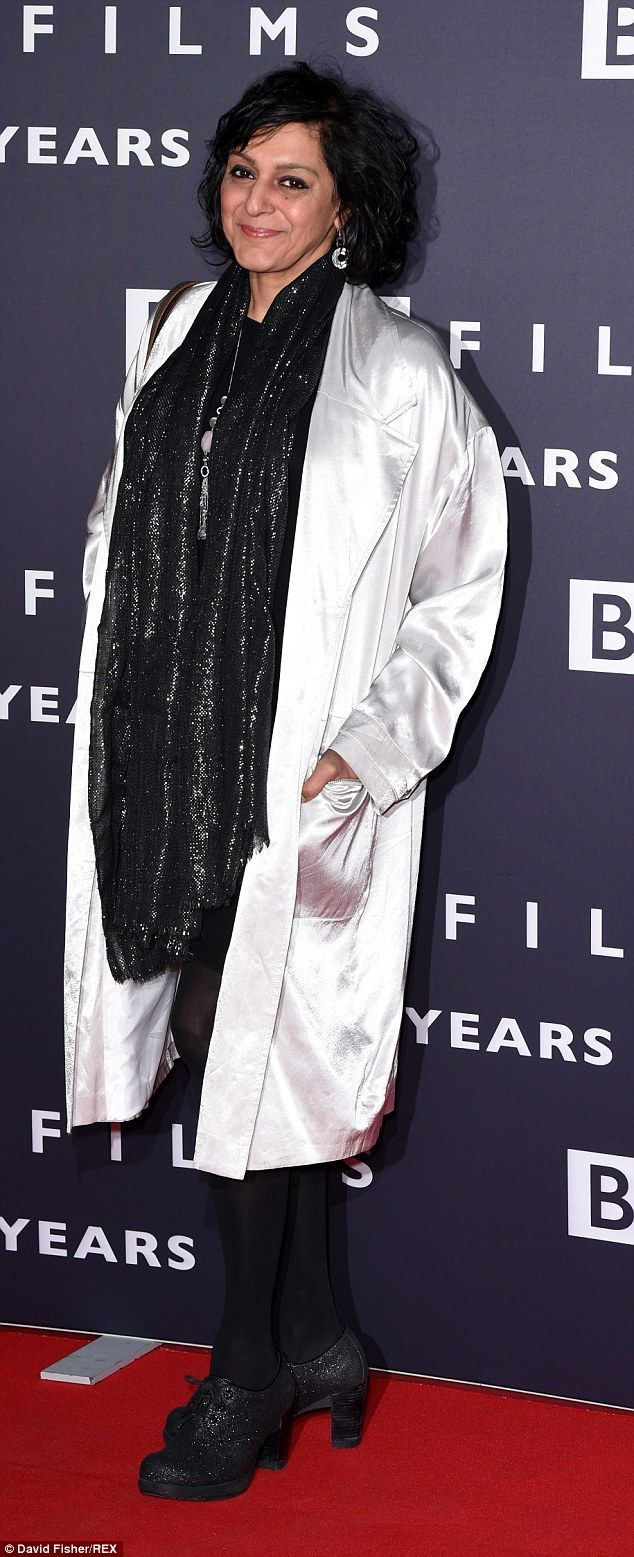 British comedian Meera Syal teamed a silver duster coat with a glittering black scarf and ...