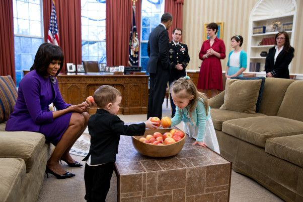 President Barack Obama and First Lady Michelle Obama visit with former Staff Sergeant Clinton Romesha and his family in the Oval Office prior to a ceremony to award Romesha the Medal of Honor, Feb. 11, 2013. Remesha's family members, from left, are: son Colin Romesha, 2; daughter Gwen Romesha, 4; wife Tammy Romesha, daughter Dessi Romesha, 11; and mother Tish Rogers.