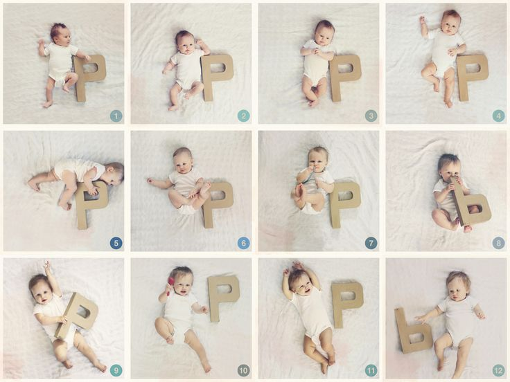 monthly photo shoot next to a cardboard letter to document my baby girl's growth, a full year!
