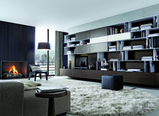 Poliform|Varenna_winter home_Soho sofa in removable fabric, Anna coffee table in spessart oak with top in hide.  Skip bookcase in spessart oak, ghiaccio lacquered shelves, ghiaccio and visone lacquered sliding doors.  Pouf Play in leather. BB armchair in hide.