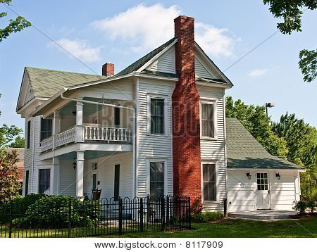 Old white two story farmhouse with red brick chimney for Farmhouse brick