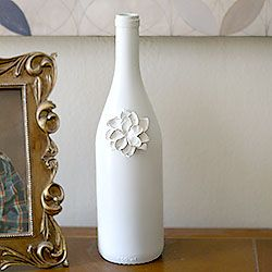 Turn a wine bottle into a beautiful vase with a little spray paint and diy polymer flowers. Great as gifts!