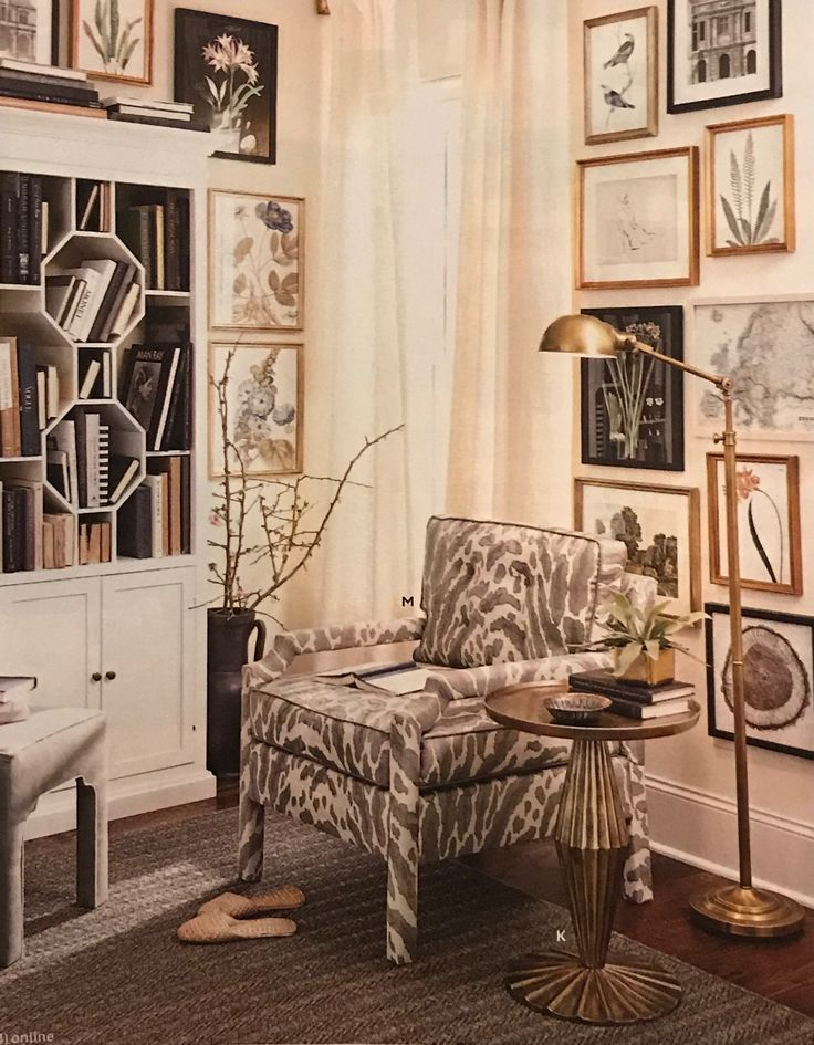 Love the frame collection on the wall behind the chair