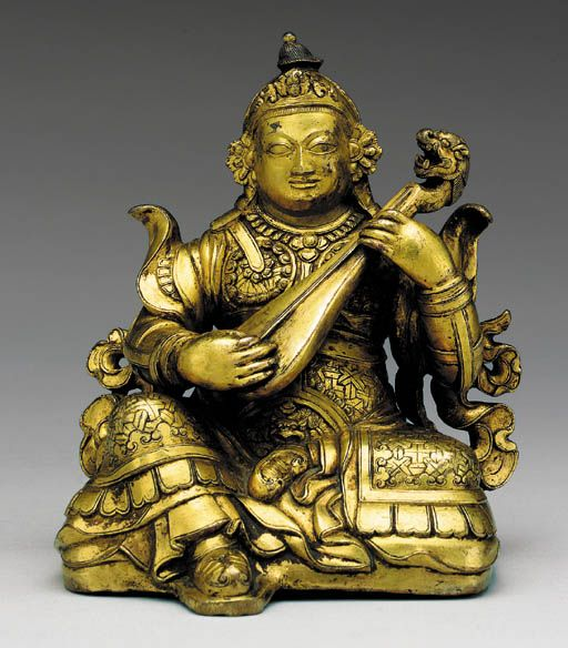 A Gilt Bronze Figure of Lokapala Dritarashtra Tibet, 15th/16th Century The guardian king of the East seated in 'Royal Ease' playing a lute modeled with a lion head, wearing finely incised armor with lotus roundel breast plates and boots with upturned tips, inscribed on the reverse 'Guardian of the right tenth region' in Tibetan, richly gilt overall and with sealed base