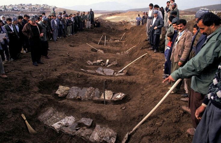 Susan Meiselas IRAQ. Sulaimaniya. 1991. Trench graves are exhumed at the former Iraqi military headquarters of Sardaw on the outskirts of Sulaimaniya. A total of 18 Iranian soldiers were found exectued in violation of the Geneva Conventions. An additional 13 civilians were buried beside them. Magnum Photos -