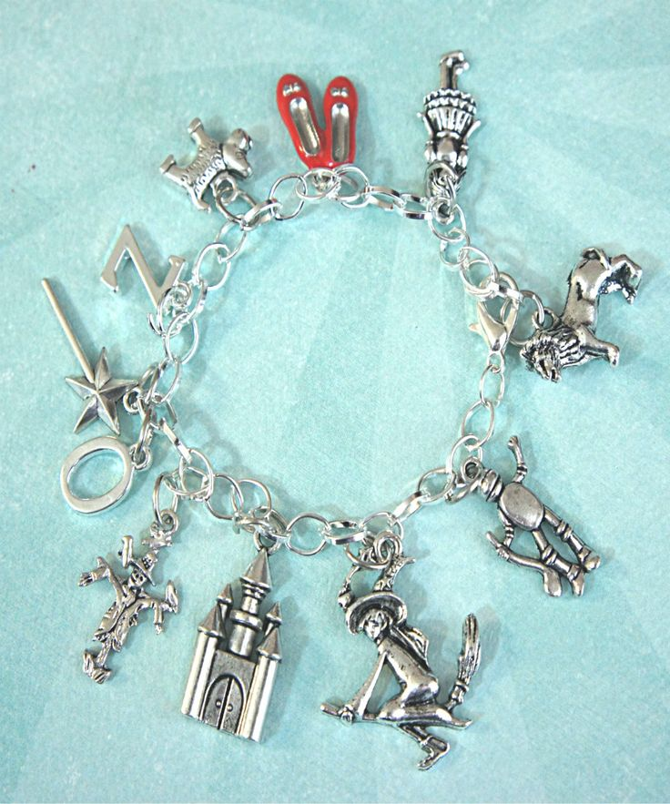 the wizard of Oz inspired charm bracelet...I nEED this...this is my favorite pin ever...