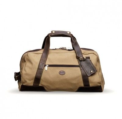 BARON   DUFFEL BAG SMALL   249€  A Duffel bag in canvas from Baron with details in leather of the best quality. The inside is lined with checkered fabric. The bag can hold 30 liters and has an inside pocket, an exterior zip pocket and a detachable adjustable shoulder strap.