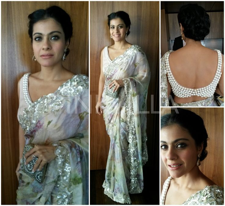 Kajol looked beautiful in a printed Shehla Khan saree which had a pearl border. A Malaga clutch, drop earrings.