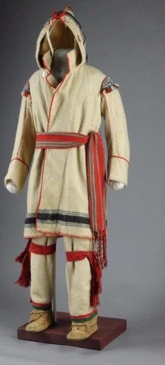 This beautiful hooded capote comes from the collection of Maine State Museum. The shoulder detail includes tinkle cones with moose hair. (Detail of the shoulder is also on this page). The capote and its accessories were treated by textile conservator, Gwen Spicer, of Spicer Art Conservation.