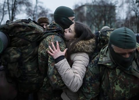 Photographer Gleb Garanich continued his strong reportage from the crisis in Kiev. Here, a new volunteer for the Ukrainian Azov battalion embraces his girlfriend before departing for the frontline in eastern Ukraine