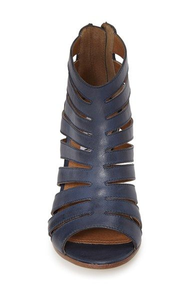 This breezy leather bootie is updated with sleek cutouts and styled with an  open toe for
